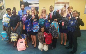 Sundance Vacations Washington DC Office Packs Book Bags for Fairfax County Family Services