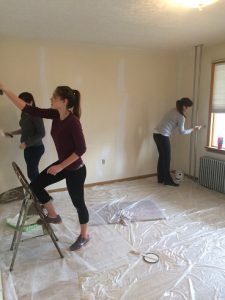 Sundance Vacations Hazleton Manager Lisa Penkala and her daughters Lauren and Ashley help spackle the home before painting.